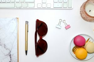 girl candle macaroons pen sunglasses flatlay desk