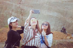 girl taking photo wear young people smiling daylight facial expression beautiful cell phone together