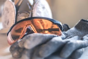 gloves sunglasses indoors blur