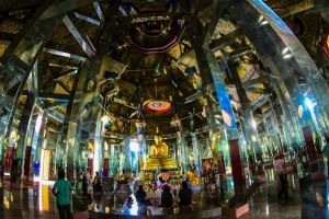 gold ornate traditional spirituality buddha pagoda wat wat phra bat huay tom tile exterior