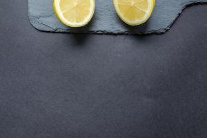 half close-up citrus fruit fresh colors citrus fruit yellow black background juicy