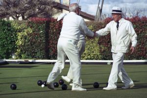handshake wear sport activity men adult sportsmanship tournament people lawn bowls