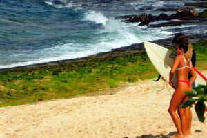 hawaii beach young couple waves breaking sand beach surfer boy sand hawaiian surfer girl young people