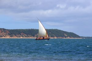 holiday mozambique nature traditional boat sand ocean africa sail people minimalism