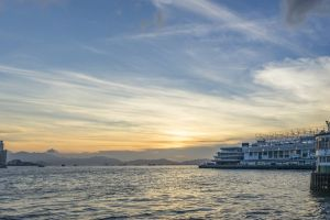 hong kong harbour cross city sea building sky ocean evening water