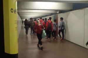 hoodie tunnel family wear indoors people red walking