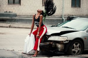 lady woman facial expression vehicle pants style car female hair street