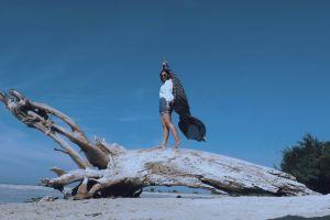 landscape action leisure sea ocean blue sky sand girl beach trunk