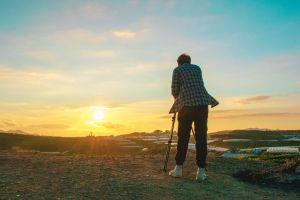 landscape sunset tripod person grass clouds daylight man sunlight golden hour