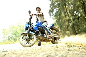 landscape transportation system grass wear wheels sunglasses dirt road motorcyclist ride motorcycle