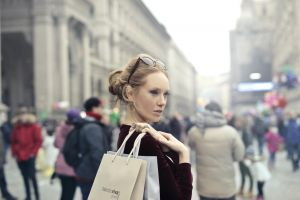 looking attractive shopping bags shopping bag earring stock people commerce spend wear