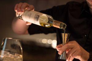 man alcoholic beverage blur drink indoors person bottle glass alcohol hands