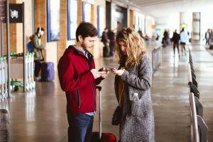 man hallway adult mobile phones couple fashion wear people blur airport