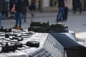 miniature sculpture street blurry background