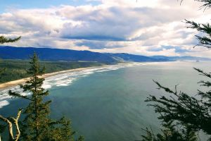 mountains oregon coast cliffs clouds landscape ocean trees pacific northwest nature sunny day