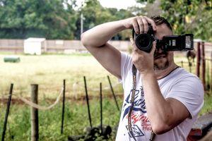 nikon style person man camera wear trees equipment field landscape