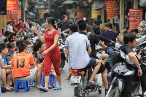 outdoor cafe crowded people crowds hanoi vietnam dining