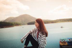 person landscape photoshoot eyewear woman daylight boats smile girl scenic