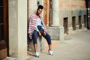 pose daytime wear model daylight person bricks human street building