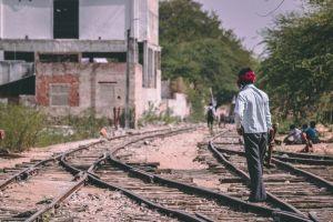 railway labor india man hammer