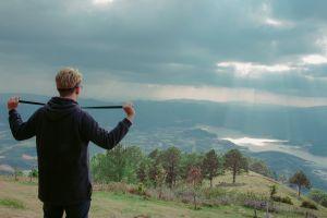 recreation person idyllic leisure sunrays cloudy sky trees landscape high