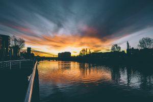 reflection architecture sun light water buildings evening landscape dawn bridge