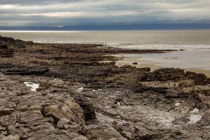 rocks sea beach cliffs porthcawl