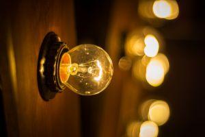 round out dark focus electricity bulb blurry illuminated light bulb design glisten