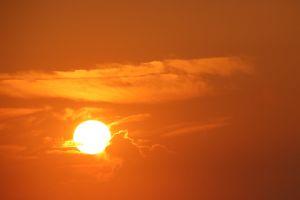 sea ocean sun reflection sunrise clouds nature holiday