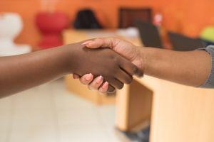 settlement formal furniture women close-up hands hand shake handshake blur girls