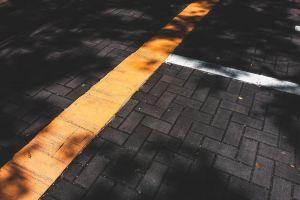 shadow daylight pattern texture yellow urban bricks dark