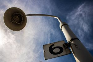 signage blue sky clouds sky electricity energy light bulb number lamppost