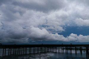sky blue wood bridge wooden bridge cloud black blue over the clouds dark clouds swamp cloudy sky