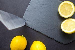slice cut dark kitchen fresh yellow fruit healthy vitamin rustic