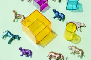 solid colorful plastic square boxes kids toy design indoors close-up figurines