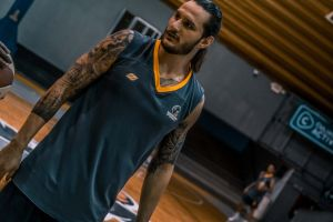 sport tattooed basketball basketball player good-looking stadium practice hairstyle uniform game