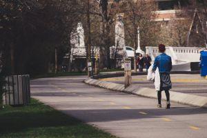 street person road walking pavement woman