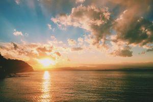 sun dawn sunset sunrise clouds water sea scenic ocean nature