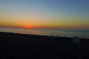 sunrise seashore shore dawn horizon beach sea sky ocean sunset