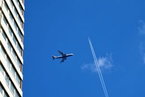 technology airliner aircrafts flight high building clouds daylight aeroplanes jet