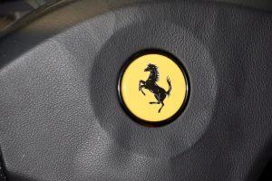 transportation steering wheel pininfarina ferrari car sports car badge close up prancing horse classic car