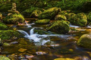 water flow nature stones rocks moss rock balancing stream
