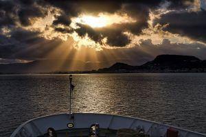 watercraft deck water golden hour boat ferry sunrays transportation system cloud formation sea seascape