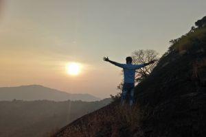 waving man sunset