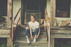 windows wood daytime female young woman jeans wooden doorway door