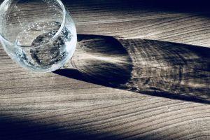 wooden table shadow light glass close-up blur transparent focus