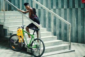 young hair stairs wheels wear bicycle woman yellow bag person steps