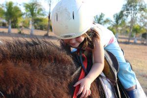 young lifestyle horseback riding helmet girl person leisure enjoyment summer fun