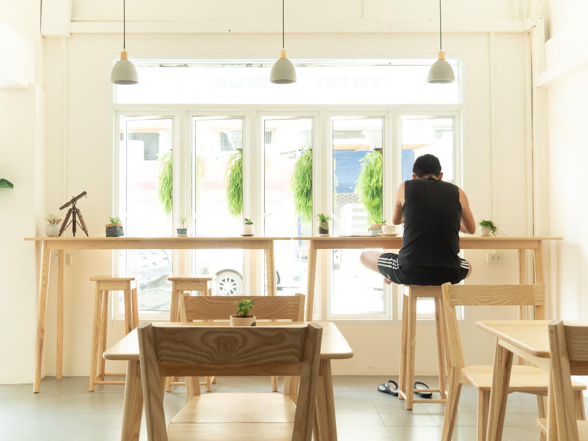 wooden glass windows modern coffee shop decor daytime vases chairs furnitures design