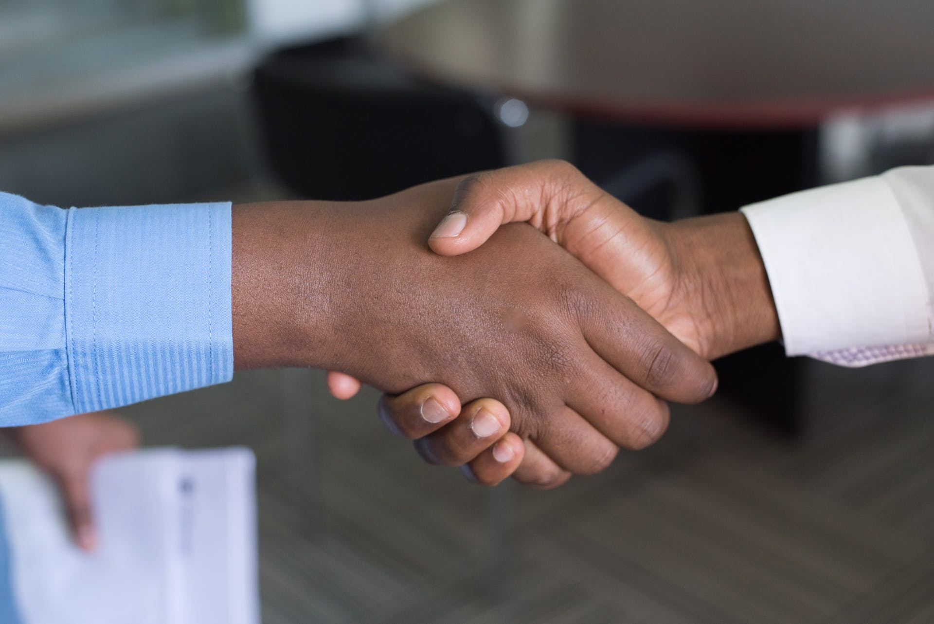 working corporate buying hands office deal black corporate attire selling handshake